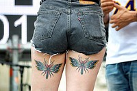 Dancer with butterfly tattoos on their thighs, Gay Pride Day 2011, Madrid, Spain