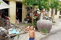 CAMBODIA. Street scene in resettlement area  Toul Sambo village is a resettlement area outside of Phnom Penh  Set in rural tranquility surrounded by p...