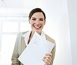Young business woman holding contract, smiling