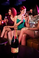 Young women enjoying champagne in nightclub