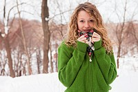 Teenage girl in snow, portrait