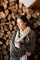 Woman in front of logs, portrait