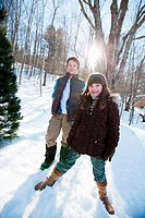 Brother and sister standing in snow, portrait