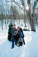 Family standing in snow, portrait