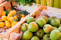 Pears and plums on fruit stall