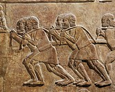 Assyrian civilization, 8th century b.C. Relief depicting workers unloading cedar wood from boats. From the Palace of Sargon at Dur Sharrukin (Khorsaba...