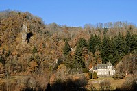 Castle in autumn landscape, Cantal, Auvergne, France