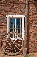 Window in Stone Building With Wagon Wheel