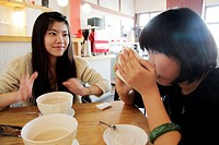 Two girls having big bowl cafe milk in a local cafe near Nan Luo Gu Xian South Luo Gu Lane the new trendy area for the bars, restaurants and boutiques...
