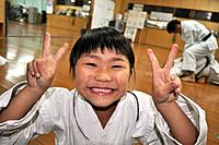 Naha (Japan): young girl making the 'V sign' during a karate class in the Shuri neighborhood; Okinawa is the birthplace of karate