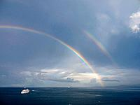 Southern Italy, Amalfi Coast, Piano di Sorrento, View of beautiful rainbow with ship in sea at dawn