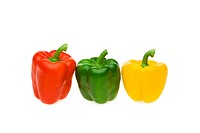 Red, green and yellow pepper on white background, close_up
