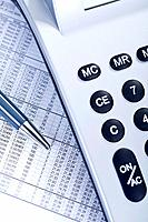 Close up of business document with calculator and pen