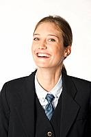Close up of young air stewardess against white background, laughing, portrait