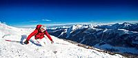 Austria, Salzburg Country, Altenmarkt_Zauchensee, Mid adult man skiing on ski slope in winter