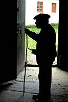 Old man by the door of a rural house