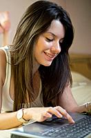 Teenage girl chatting with notebook in her home