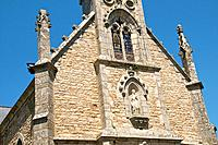 Steeple and Facade of Saint Sauveur church, detail , with virgin and stained glass, Saint Goustan old quarter, AURAY, Brittany, France , (detail)