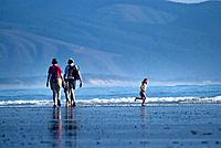 Family enjoying summer afternoon at an Oregon beach