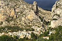 The village of Moustiers-Saint-Maries with storm clouds gathering over the mountains, France, Europe