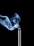 burning cigarette smoke isolated on black background