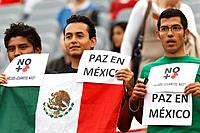 LEVERKUSEN, GERMANY - JULY 1: Mexico supporters in the stands at a FIFA Women´s World Cup Group B match between Japan and Mexico hold signs reading ´P...