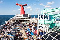 Cruise passengers watching NFL football game on deck of Carnival's Triumph cruise ship in the Gulf of Mexico