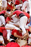 Castellers Colla Joves Xiquets de Valls  Human tower falling ´Castellers´ is a Catalan tradition Fira de Santa Úrsula Valls  Tarragona province, Spain