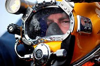 NORTH SEA July 27, 2011 Navy Diver 2nd Class Martin Horan, assigned to Mobile Diving and Salvage Unit MDSU 2, prepares for a dive aboard the Military ...