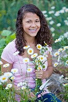 Teen girl with a bouquet of daisies
