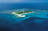 New Caledonia (Overseas territory of France) - Atoll - Amédée Lighthouse marks entrance channel to coral reef.