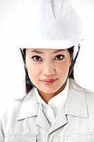 Portrait of female architect with a hardhat