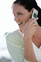 Close_up of a mid adult woman talking on a mobile phone