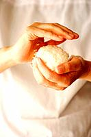 Woman making rice ball Onigiri