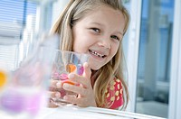 Close_up of a girl holding a glass of water