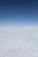 View above the clouds from airplane window, France, Europe
