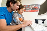 Father and his son using a computer