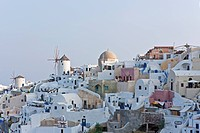 homes and windmill in the village of Oia in Santorini, Cyclades Islands, Cyclades Prefecture, Greece, Europe