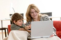 Mother and her son using a laptop
