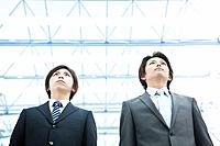 Businessmen standing, low angle view
