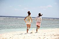 Young women jogging on beach, Guam USA