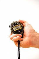 Close_up of adult male hand holding stopwatch.