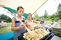 Girls cooking Yakisoba Fried Noodles on a grill, Chiba Prefecture, Honshu, Japan