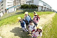 Portrait of school children at riverbank, fish_eye lens
