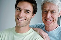 Portrait of a senior man and his son smiling