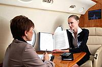 Businesswomen having discussion in private jet