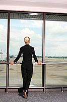 Businesswoman waiting for her flight in airport lounge