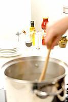Woman boiling pasta