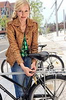 Female biker locking her bicycle