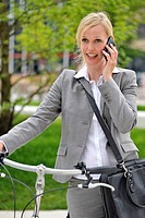 Female cyclist being on the phone